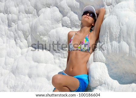 Travertine pools and terraces, Young woman in Pamukkale, Turkey - stock photo