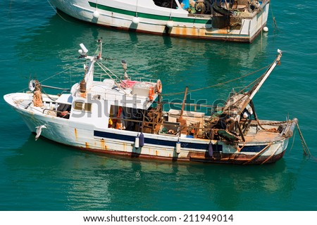 Trawler Fishing Boat - Liguria Italy / Old trawler fishing boats with fishing equipment docked in port - Lerici, La Spezia, Liguria, Italy - stock photo