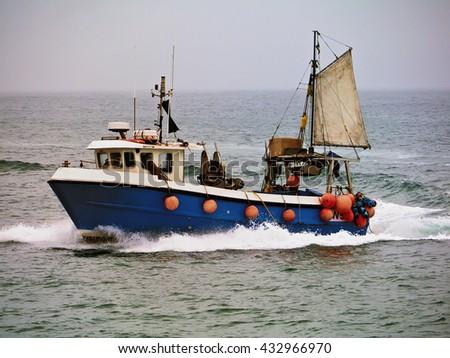 Trawler; trawler under way in misty weather  - stock photo