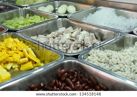 tray of assorted food for salad buffet in local market The salad in local market is most often composed of vegetable, sweet corn, boiled taro, pea or green pea, nut, cucumber,jelly,lettuce - stock photo