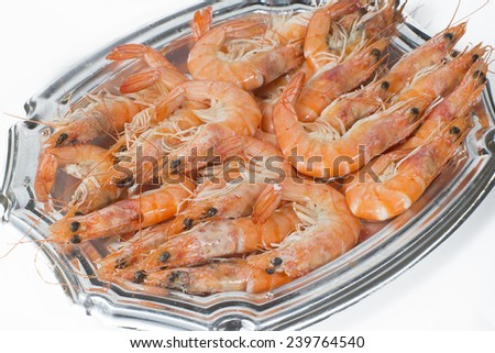 Tray of cooked prawns on white background