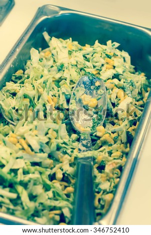 Tray of creamy coleslaw with corn in salad bar tray - stock photo