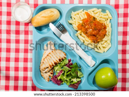Tray of food for school meals - stock photo