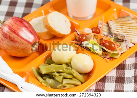Tray of food in a school canteen - stock photo