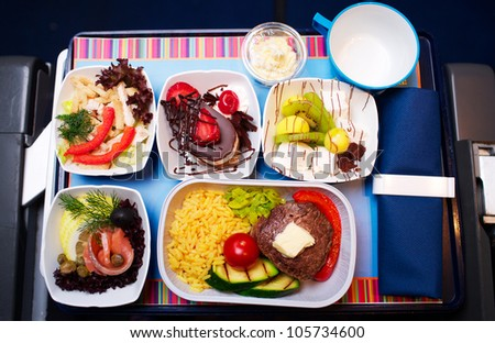 Tray of food on the plane - stock photo