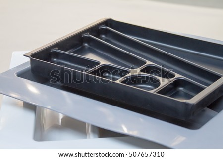 Tray of forks and spoons. Organizer for Cutlery. The manufacture of furniture. Furniture accessories.