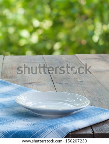 tray on a wooden table on a background of a summer garden - stock photo