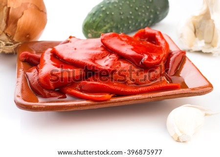 tray skinless roasted peppers on white background;