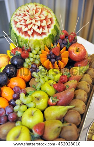 Tray with assorted fruit in a hotel buffet