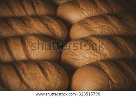 Tray with bread. long loaf - stock photo