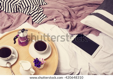 Tray with coffee and milk in bed