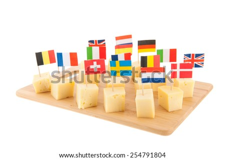 Tray with European cheese cubes with flags - stock photo