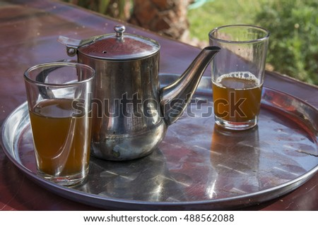 Tray with tea and Moroccan tea glasses in a restaurant on the coast of Agadir