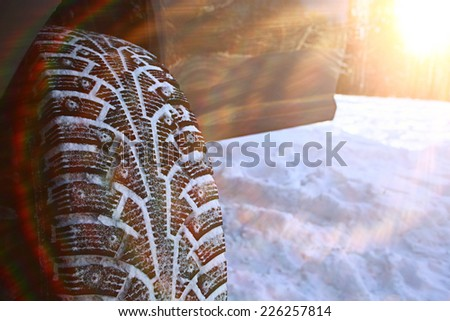 tread wheels Winter studded tires snow - stock photo