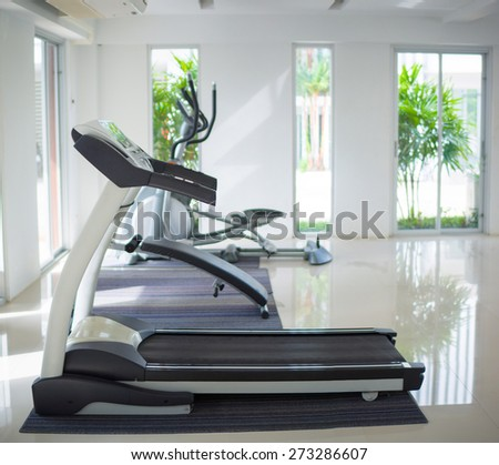 Treadmill trainer in a fitness gym