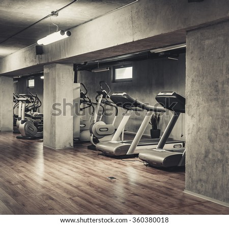 Treadmills exercise machines standing in a row in gym - stock photo