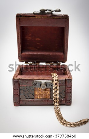 Treasure chest.chest with jewelry,a gold chain,an old trunk,wedding ring,gold jewelry