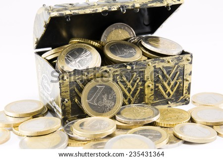 treasure chest filled with gold and silver coin, euro currency - stock photo