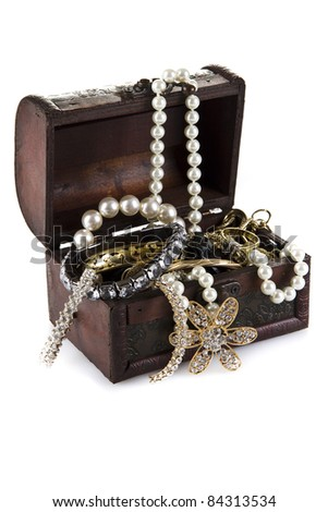 Treasure Chest full of jewelery  isolated over white background - stock photo