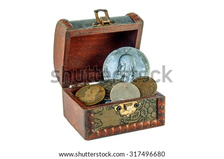 Treasure chest isolated on white background. The Chest is full of coins. Concept for lost treasure chest - stock photo