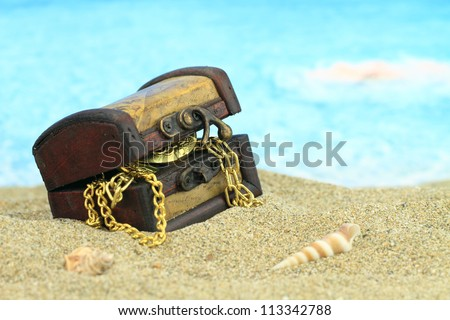 Treasure chest on a beach - stock photo