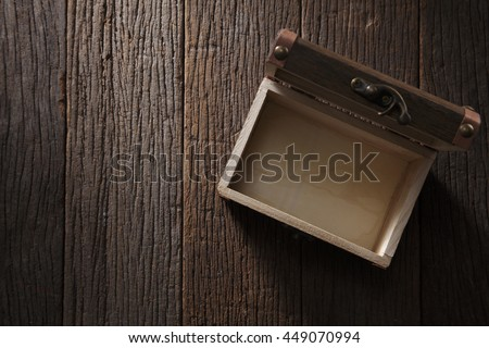 treasure chest on the wooden background - stock photo