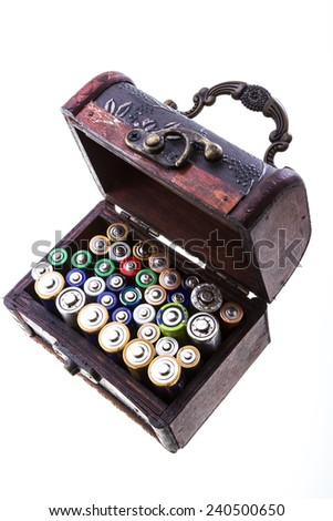 Treasure chest with batteries isolated on white. - stock photo