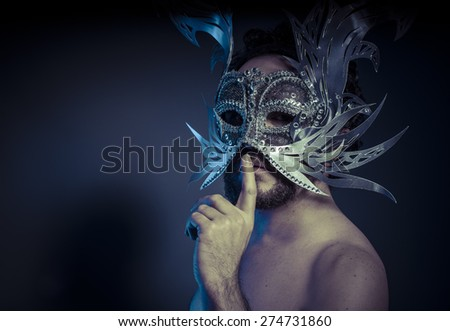 Treasure, jewels and silver. Man with mask of precious metals - stock photo