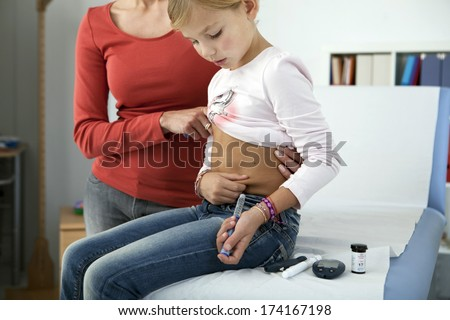 Treating Diabetes In A Child - stock photo