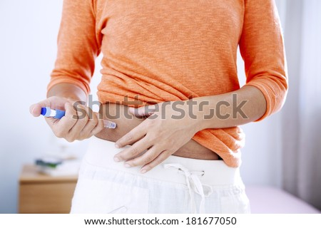 Treating Diabetes In A Woman - stock photo