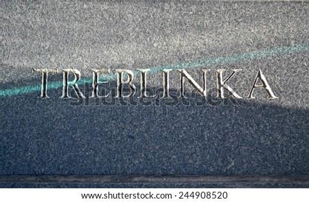 treblinka concentration camp, message closeup on stone wall  - stock photo