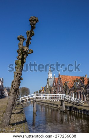 Tree and bridge in the historical center of Sloten, Netherlands - stock photo