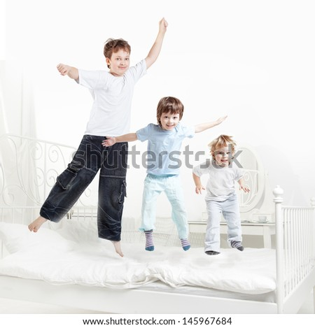 tree boy jump on bed