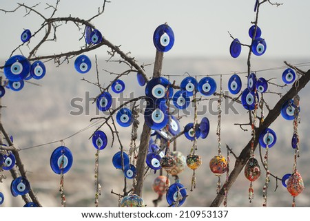 Tree covered in 'Nazar' charms in Cappadocia, Turkey