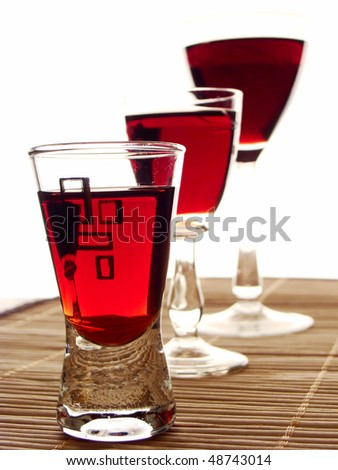 tree glasses of cordial - one behind the second - stock photo