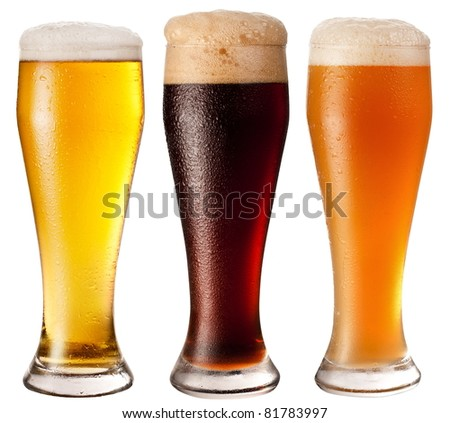 Tree glasses with different beers on a white background. The file contains a path to cut. - stock photo