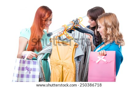 Tree happy women shopping in clothes store, isolated on white - stock photo