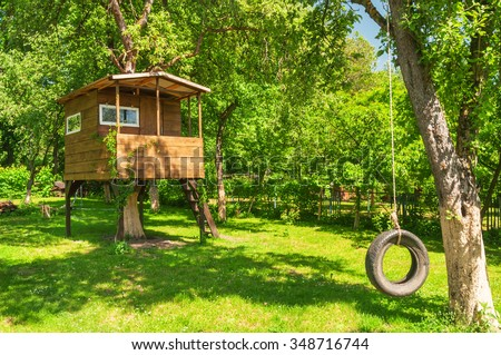tree house in the evening garden - stock photo