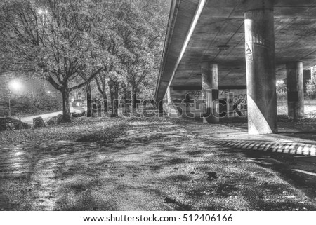 Tree lined pathway along viaduct bristol hdr black and white photography