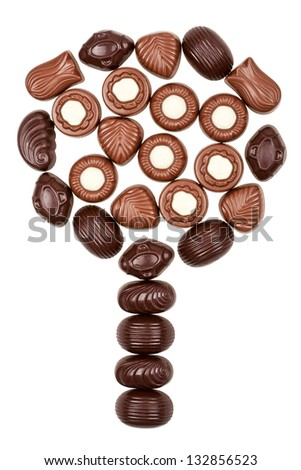 Tree made of chocolate candies isolated on white background