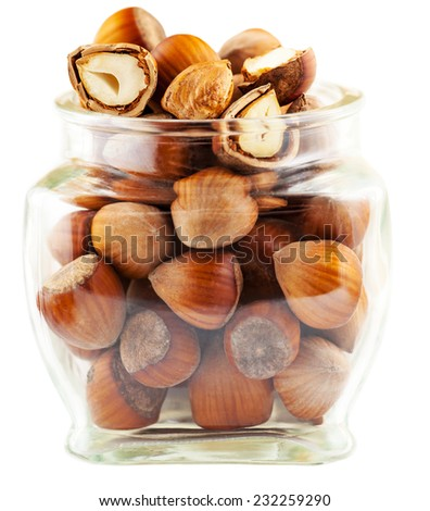 tree nuts in a glass jar isolated on white background - stock photo