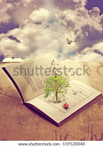 Tree of knowledge in opened book - stock photo