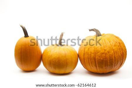 tree orange pumpkins in line for halloween decoration - stock photo