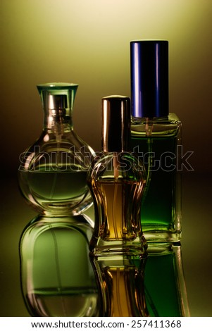 Tree perfume bottles with reflection