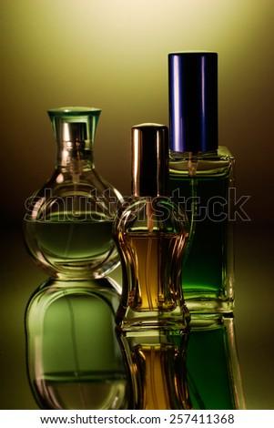 Tree perfume bottles with reflection - stock photo