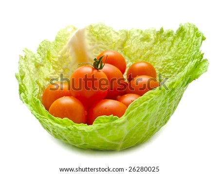 tree small tomatoes in the cabbage leaf