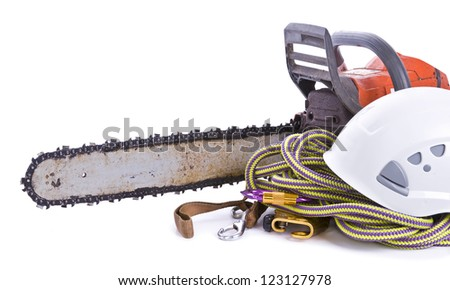 tree surgeon tools including chainsaw, helmet, harness and rope on white landscape - stock photo