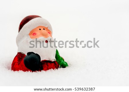 Tree toy Santa Claus in the snow