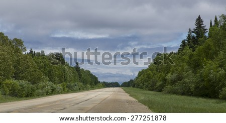 Trees along gravel road, Riverton, Hecla Grindstone Provincial Park, Manitoba, Canada - stock photo