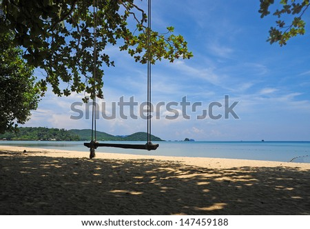 Trees and a hammock by the sea